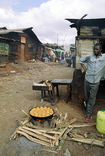 Man cooking in Kibera Slum, Africa.