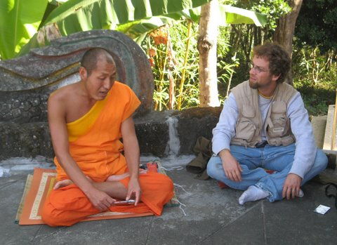 Joshua Samuel Brown chatting with a monk.